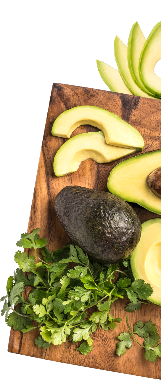 fresh cut avocados on cutting board