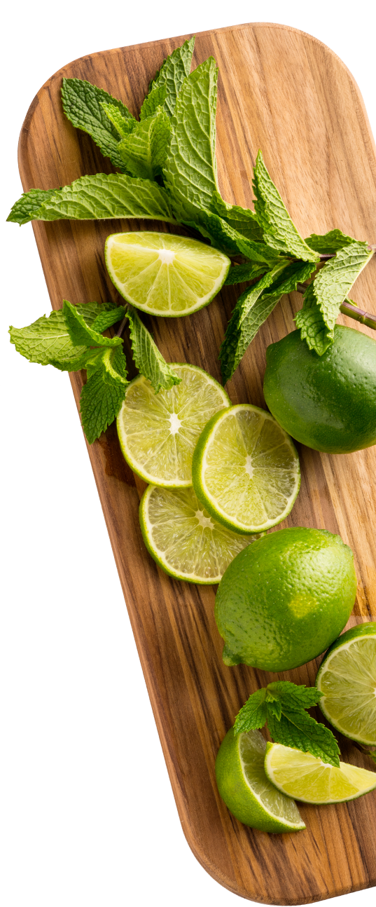 fresh cut limes on cutting board