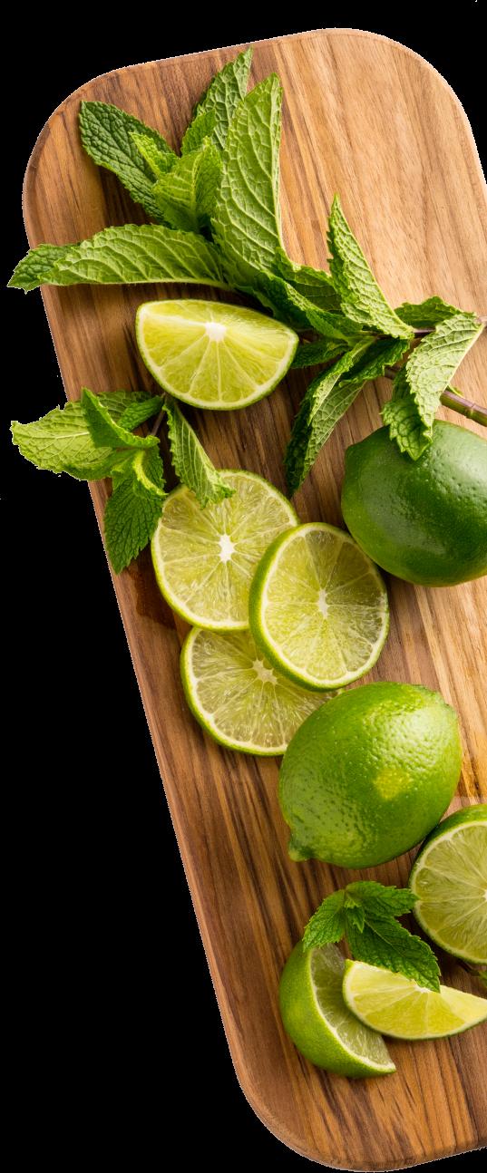 fresh cut limes on cutting board