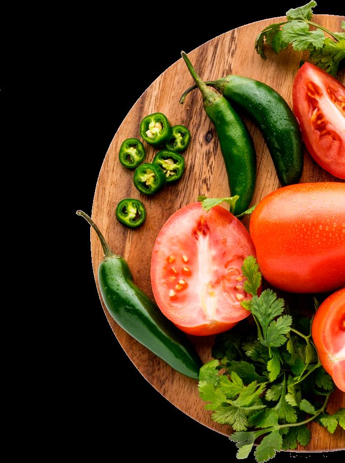 fresh cut tomatoes on cutting board
